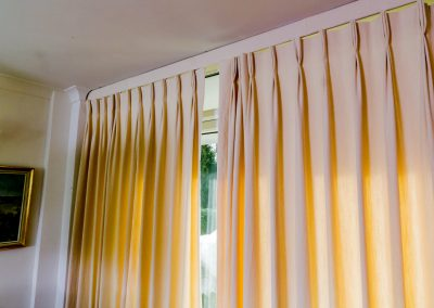 Full length cream curtains with triple pleats