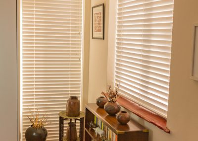 Full length and half-length white venetian blinds