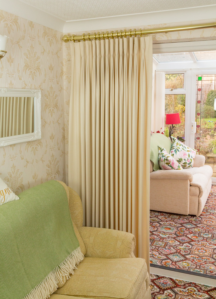 Cream full length triple pleated curtains
