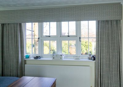 Full length grey geometric curtains with matching box pelmet